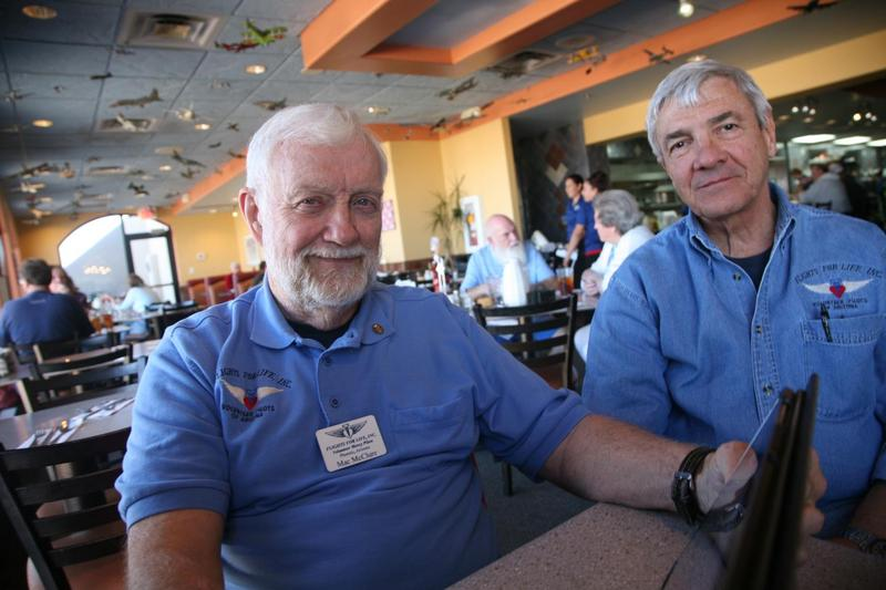 Mac McClure (left) flew more than 800 blood missions for Flights for Life. Volunteer pilots with the group help supply remote hospitals with blood every day. McClure died Tuesday in a plane crash. Ray Reher is also pictured here. (Stina Sieg/KJZZ)