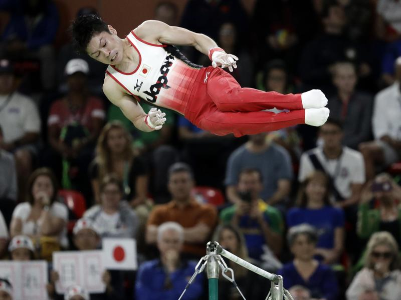 Japan's Kohei Uchimura performs on the horizontal bar during men's individual all-around final on Wednesday. Uchimura, widely considered to be the best male gymnast ever, repeated as the gold medalist in the event.