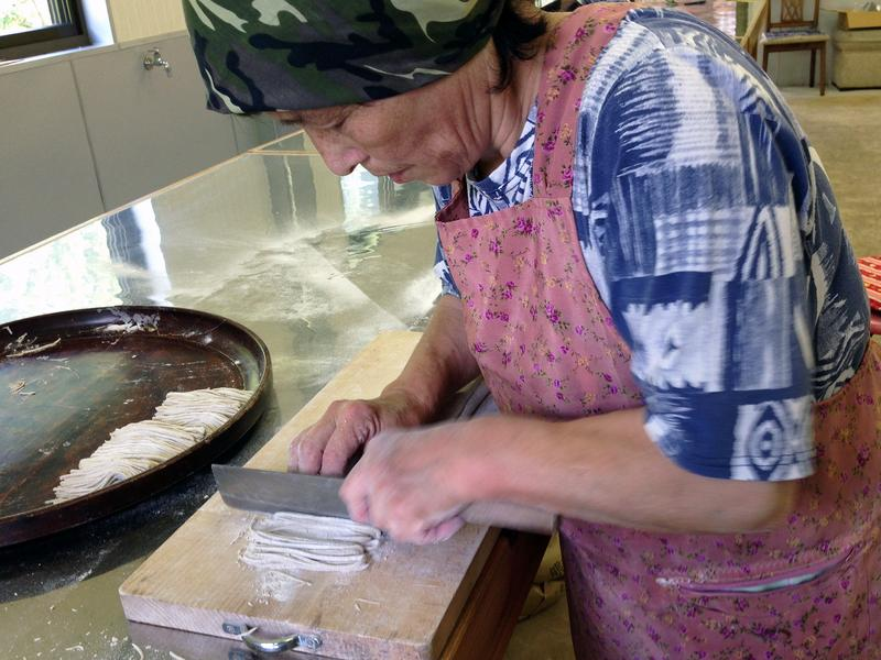 Reiko Tsuzuki, 70, makes buckwheat soba noodles by hand in her restaurant kitchen in the Japanese island of Shikoku.