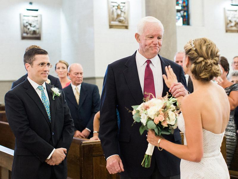 Jeni Stepien with her hand on Arthur Thomas' chest after he walked her down the aisle at her wedding last Friday. The groom, Paul Maenner, stands to the left.