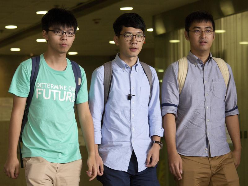Hong Kong student protest leaders (from left) Joshua Wong, Nathan Law and Alex Chow avoided jail time for their part in an illegal rally that inspired pro-democracy protests throughout the city two years ago.