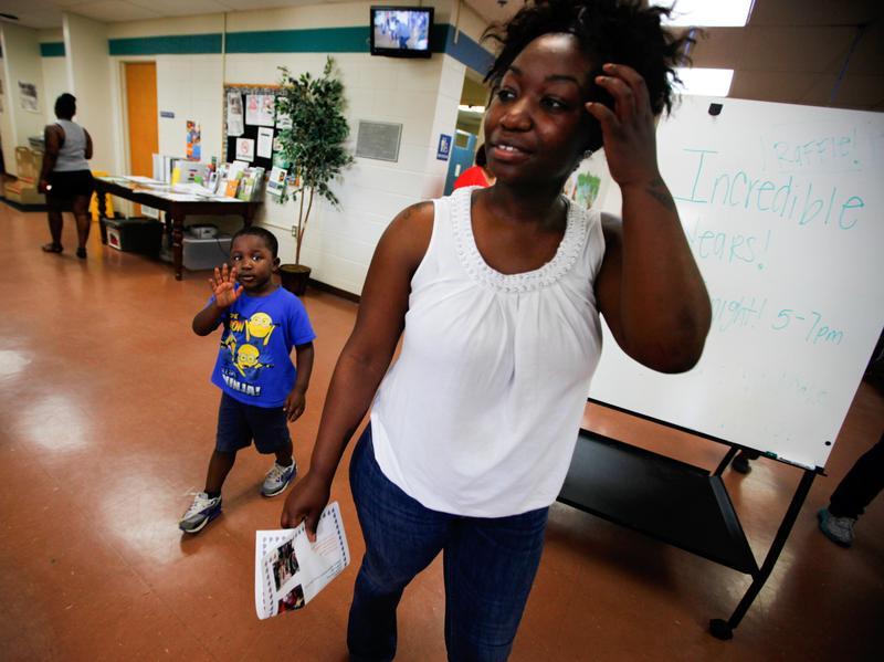 Shartara Wallace picks up her son James, 4, from preschool in Tulsa, Okla., in 2014.