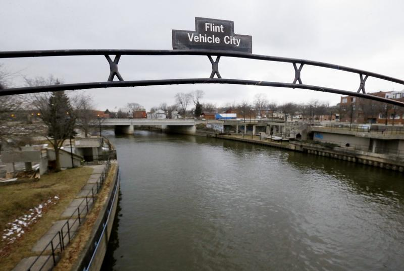 On Aug. 11, 2016, researchers said the city's water quality has greatly improved, based on tests at more than 160 homes. This file photo shows a sign over the Flint River there. (Carlos Osorio/AP)