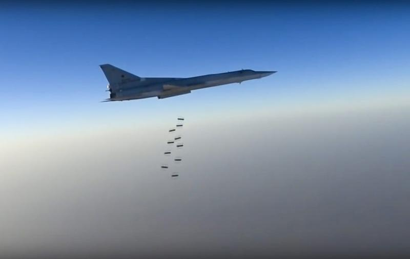 In this frame grab provided by the Russian Defence Ministry Press Service Russian, a long range bomber reportedly flies during an airstrike in an undisclosed location in Syria. (Russian Defence Ministry via AP)