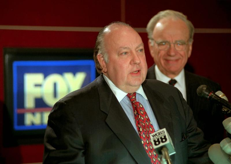In this 1996 file photo, Roger Ailes, speaks after being named chairman of Fox as Rupert Murdoch looks on. He left the network after a sexual harassment lawsuit. (Richard Drew/AP)