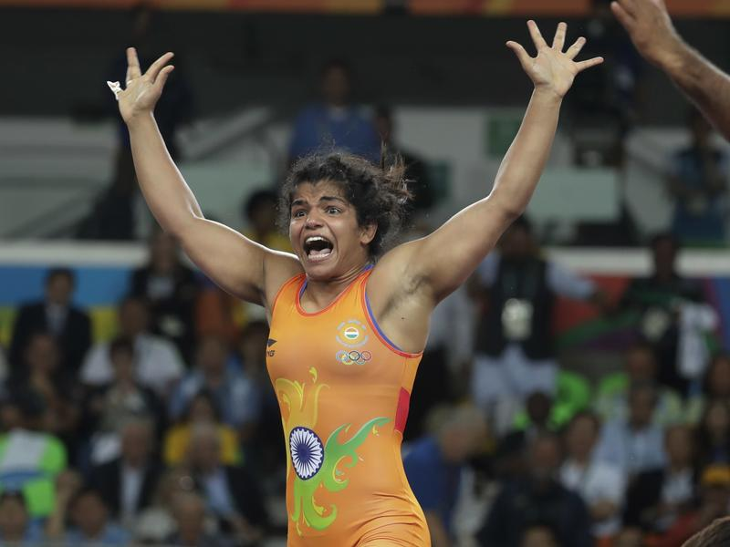 India's Sakshi Malik reacts after winning bronze in the women's wrestling freestyle competition.
