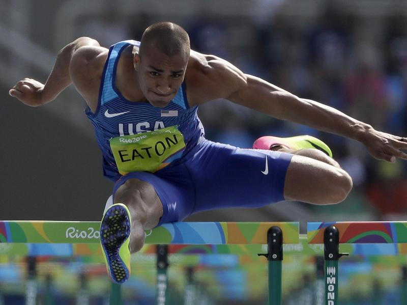 American Ashton Eaton competes in the decathlon 110-meter hurdles Thursday in Rio. He won the decathlon for the second time, becoming just the third man to successfully defend his title.