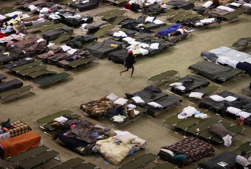 Evacuees take advantage of the shelter setup in the The Baton Rouge River Center arena on Aug. 19, 2016 in Baton Rouge, Louisiana. (Joe Raedle/Getty Images)