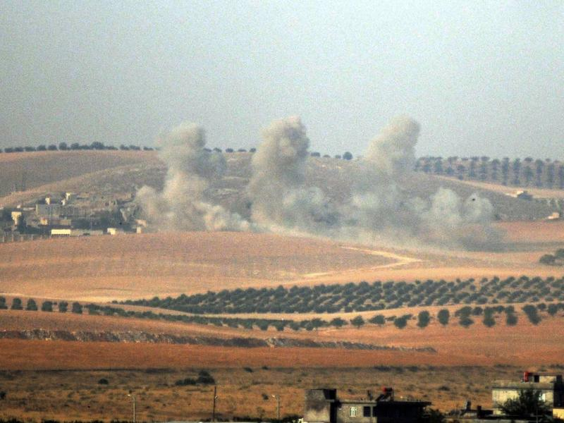 Smoke billows in the Syrian border area, photographed Wednesday from across the border in Karkamis, Turkey.