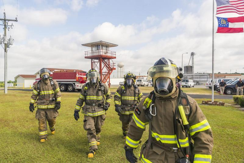 Firefighters from the Dodge State Prison fire department during a recent training demonstration. (Grant Blankenship/GPB)