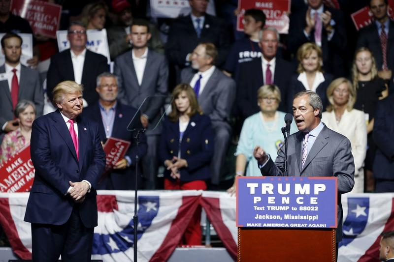 Nigel Farage, ex-leader of the British UKIP party, speaks as Republican presidential candidate Donald Trump, left, listens, at Trump's campaign rally in Jackson, Mississippi, Wednesday, Aug. 24, 2016. (Gerald Herbert/AP)