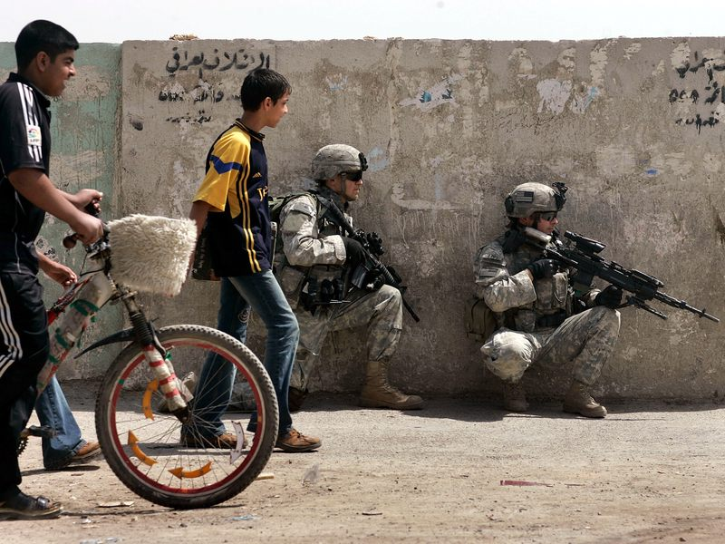 U.S. Army soldiers take up a position during a patrol in Baghdad in 2007. The U.S. has been waging war nonstop for 15 years since the Sept. 11 attacks. Despite the protracted conflicts and disappointing results, U.S. involvement in multiple wars appears set to continue for years to come.