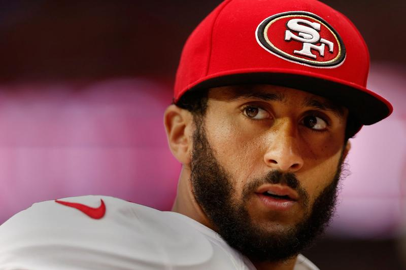 Quarterback Colin Kaepernick of the San Francisco 49ers watches from the sidelines during an NFL game against the Arizona Cardinals on Sept. 27, 2015 in Glendale, Arizona. (Christian Petersen/Getty Images)