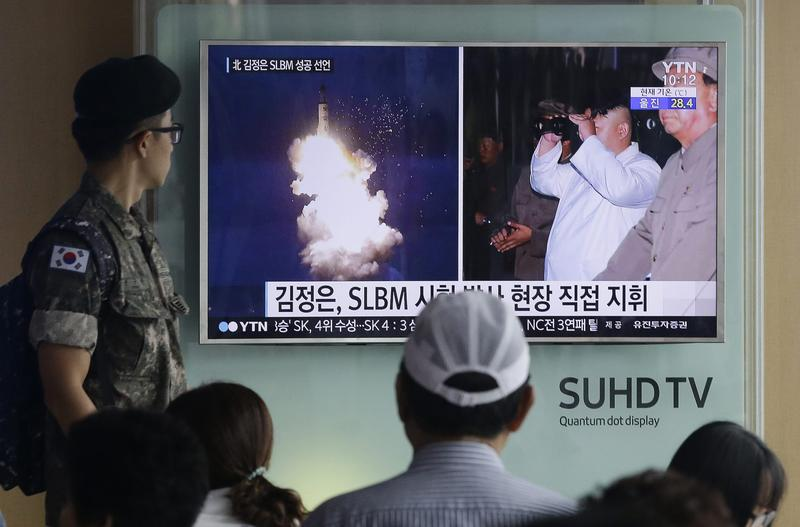 In this Thursday, Aug. 25, 2016, file photo, a South Korean army soldier watches a TV news program showing images published in North Korea's Rodong Sinmun newspaper of North Korea's ballistic missile believed to have been launched from underwater and North Korean leader Kim Jong-un, at Seoul Railway station in Seoul, South Korea. (Ahn Young-joon/AP)