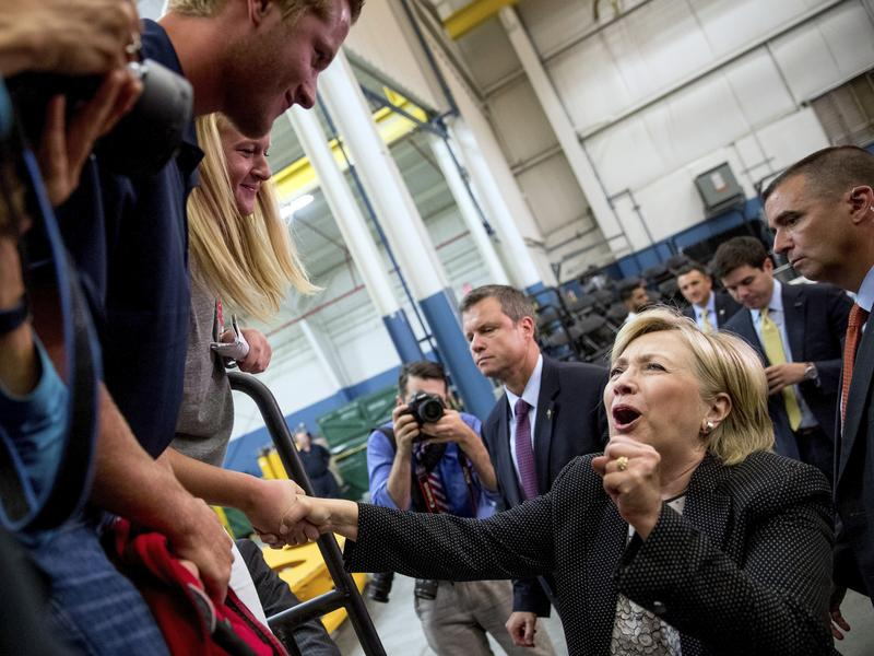 Democratic presidential candidate Hillary Clinton reacts while greeting supporters after giving a speech on the economy at Futuramic Tool & Engineering, in Warren, Mich., on Aug. 11.