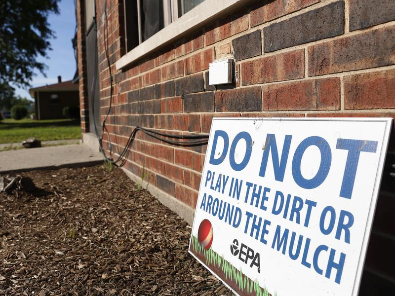 A sign from the Environmental Protection Agency posted in front of West Calumet Housing Complex houses in East Chicago, Ind.