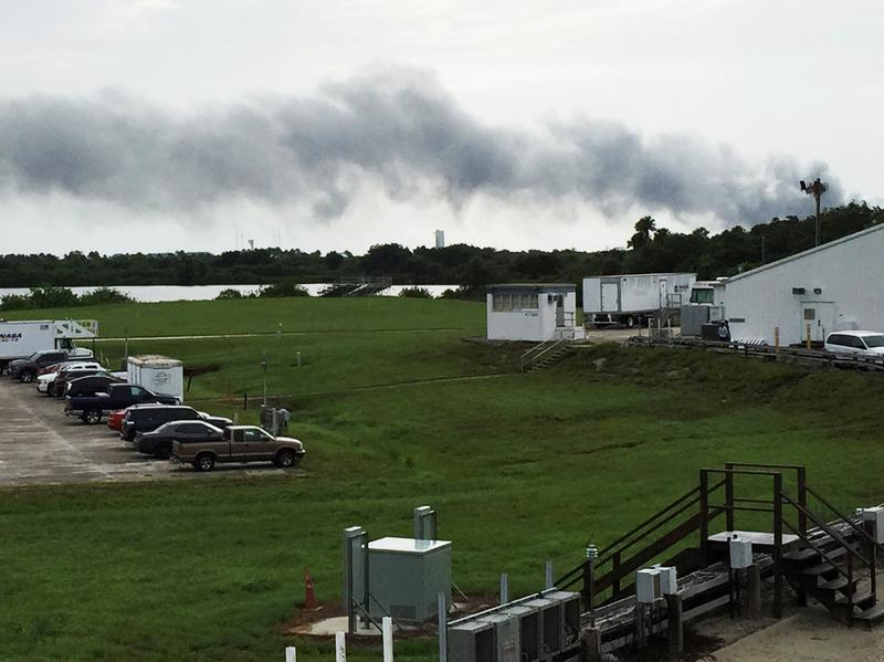 Smoke rises from a SpaceX launch site at Cape Canaveral, Fla., on Thursday. NASA said SpaceX was conducting a test firing of its unmanned rocket when a blast occurred.
