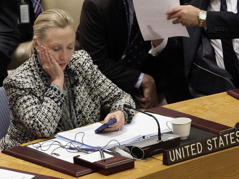 Hillary Clinton checks her phone after addressing the Security Council at the United Nations as secretary of state in 2012.