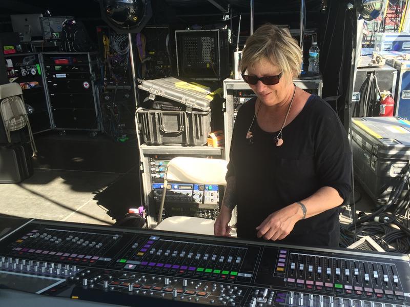 Karrie Keyes stands at her soundboard at a show at Boston's Fenway Park in August 2016. From here, she communicates with the members of Pearl Jam to get the monitor mix just right.