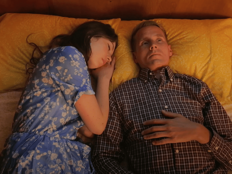 """A couple lie in bed together in a scene from Tom Brosseau's video for the song, """"You Can't Stop."""""""