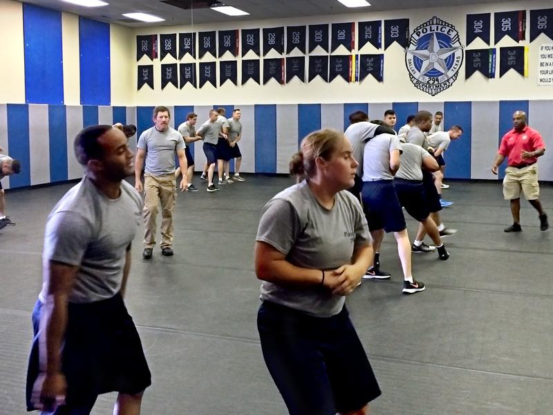 Trainees participate in a tactical defense class at the Dallas Police Basic Training Academy. The officer deaths in July strengthened the camaraderie among recruits training at the academy.