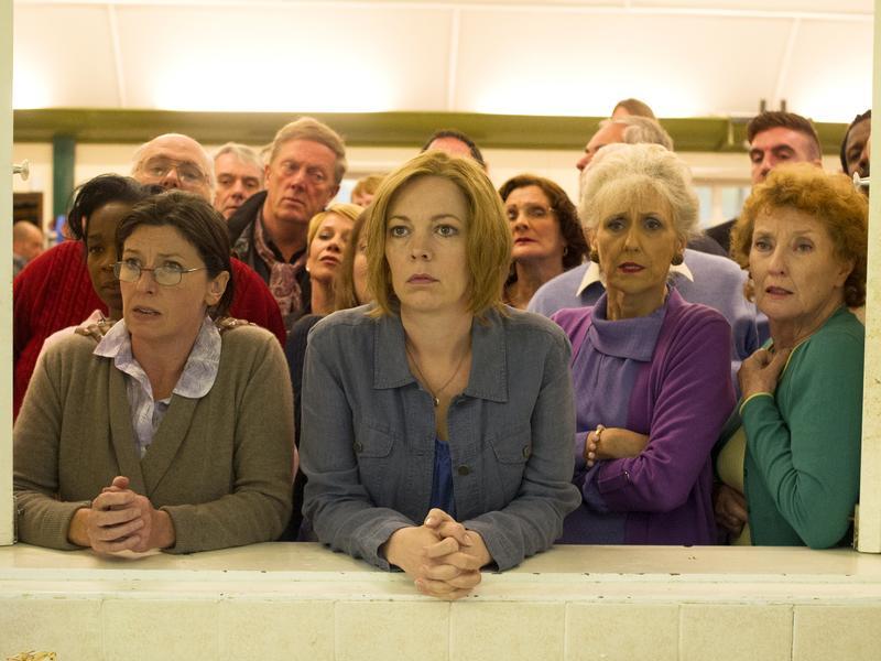 Julia (Olivia Colman, center left) and June (Anita Dobson, center right) in the musical <em>London Road</em>.