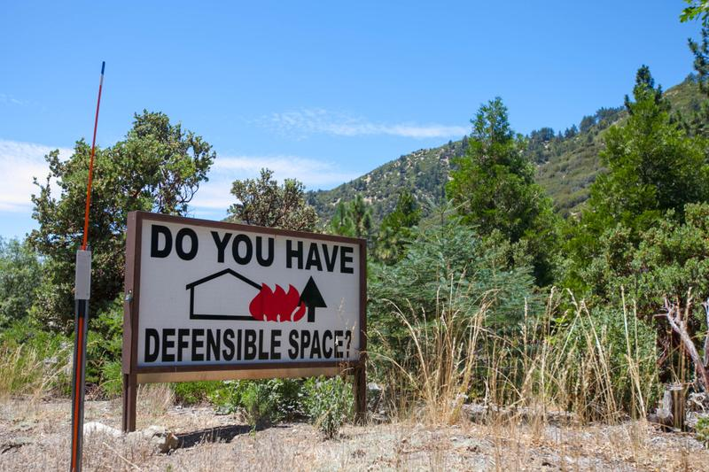 Property owners living close to wilderness areas must remain vigilant; embers can also travel large distances and ignite properties within housing tracts. (Susanica Tam for KPCC)