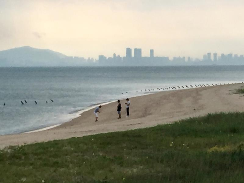 Skyscrapers in the mainland China city of Xiamen are seen in the distance from a beach on Taiwan's Kinmen Island.
