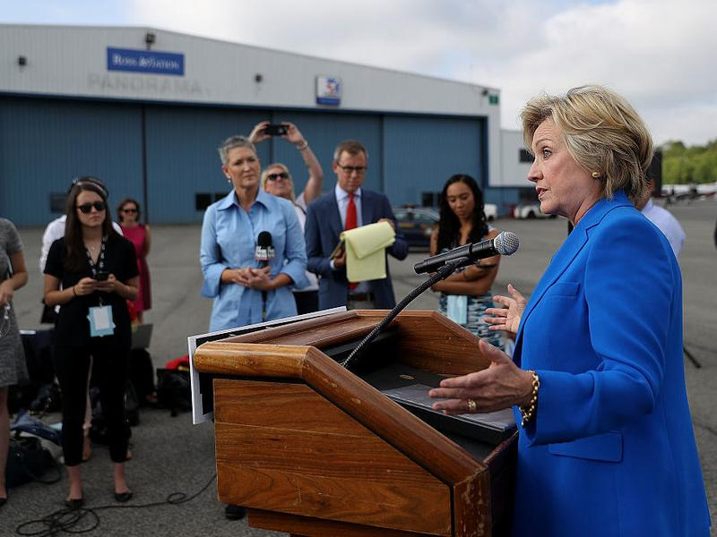 Hillary Clinton speaks to reporters on the tarmac on September 8 in New York.