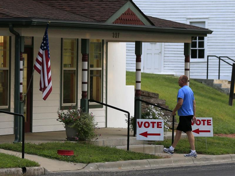 A voter enters city hall in Lecompton, Kan., to vote in the state's primary election last month.