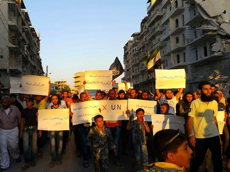 "Activists in Syria's besieged city of Aleppo protest Tuesday against the United Nations for what they say is its failure to lift the siege of their rebel-held area. ""Hunger better than humiliation,"" one banner read. ""X the UN,"" another declared."