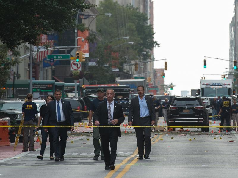 New York Governor Andrew Cuomo (R) visits the scene of an explosion on West 23rd Street Sept. 18, 2016 in New York. An explosion rocked one of the most fashionable neighborhoods of New York, injuring 29 people, one seriously, a week after America's financial capital marked the 15th anniversary of the 9/11 attacks.