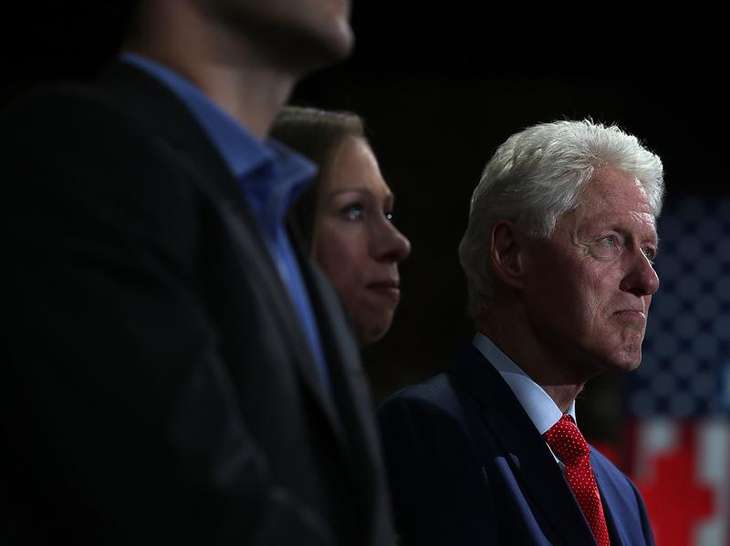 Former president Bill Clinton and his daughter, Chelsea Clinton, watch Hillary Clinton speak during a primary election night gathering April 19 in New York City.