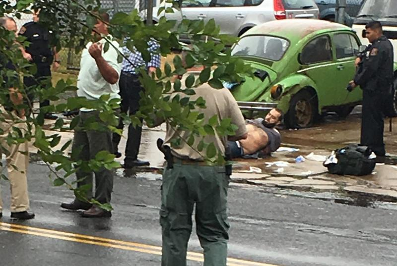 Ahmad Khan Rahami is taken into custody after a shootout with police Monday, Sept. 19, 2016, in Linden, N.J. Rahami was wanted for questioning in the bombings that rocked the Chelsea neighborhood of New York and the New Jersey shore town of Seaside Park. (Moshe Weiss via AP)