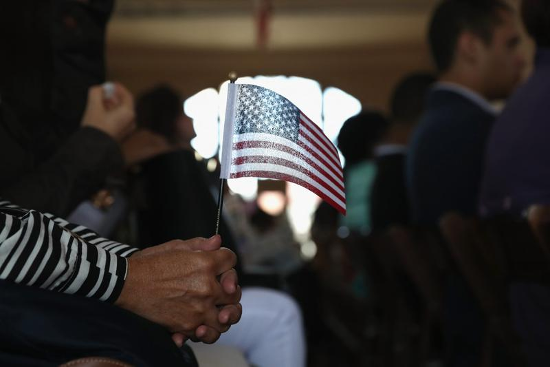 Immigrants become American citizens at a naturalization ceremony on Ellis Island on Sept. 16, 2016, in New York. (John Moore/Getty Images)