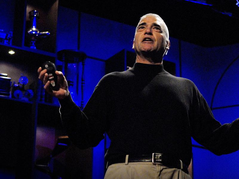 Paleontologist Peter Ward speaking on the TED stage.