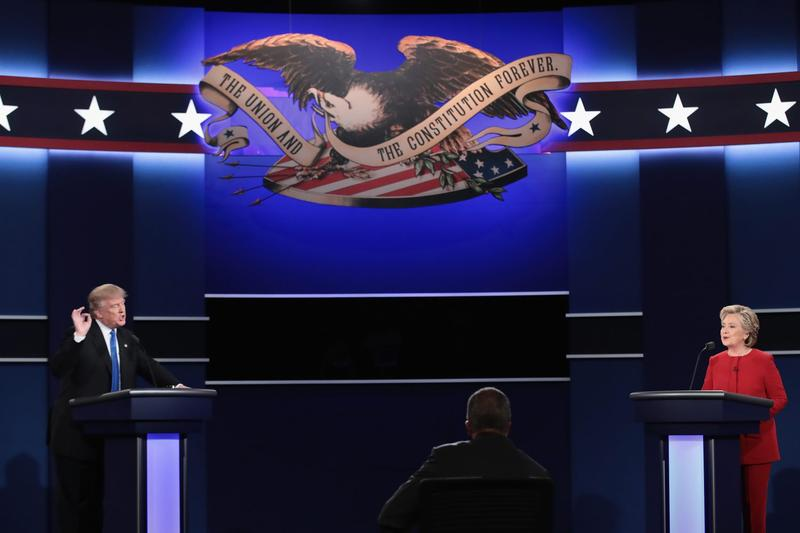 Republican presidential nominee Donald Trump (left) speaks as Democratic presidential nominee Hillary Clinton listens during the Presidential Debate at Hofstra University on Sept. 26, 2016, in Hempstead, N.Y. (Drew Angerer/Getty Images)