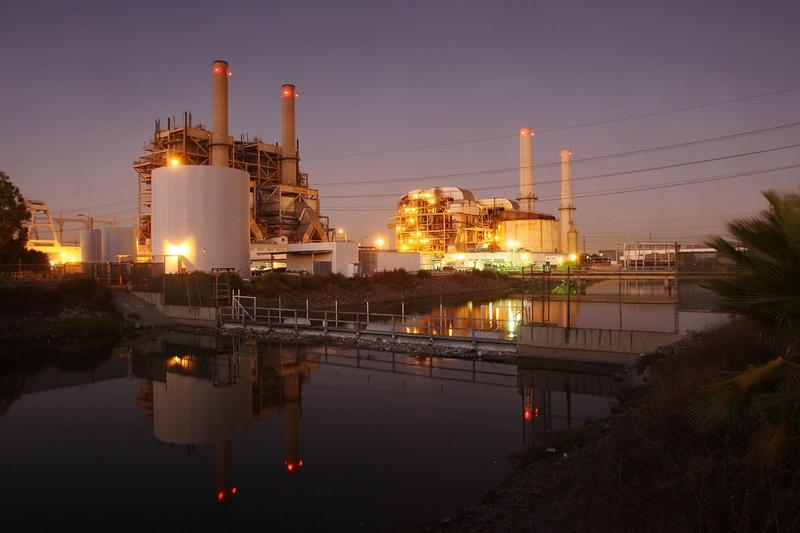 The court battle starts this week on the Obama administration's environmental regulations on greenhouse gas emissions from power plants and large industrial facilities. The photo shows the AES Corporation 495-megawatt Alamitos natural gas-fired power station on Oct. 1, 2009, in Long Beach, Calif. (David McNew/Getty Images)