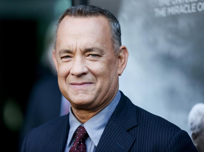 Tom Hanks walked the red carpet at the premiere of <em>Sully</em> in Los Angeles on Sept. 8. He also walked into a couple's wedding pics in Central Park recently.