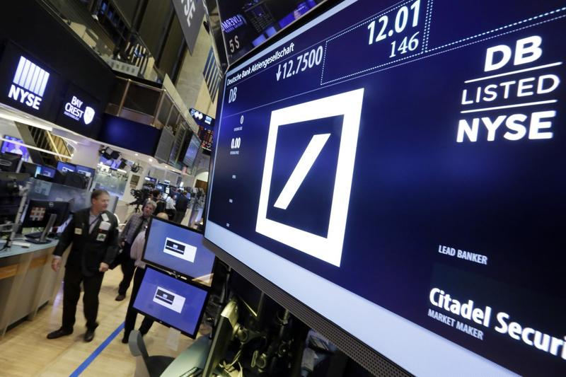 Shares in Deutsche Bank are down sharply after a report that the German government won't intervene with U.S. officials who are pressing the bank to pay $14 billion to settle an investigation into its sales of mortgage-backed securities. (Richard Drew/AP)