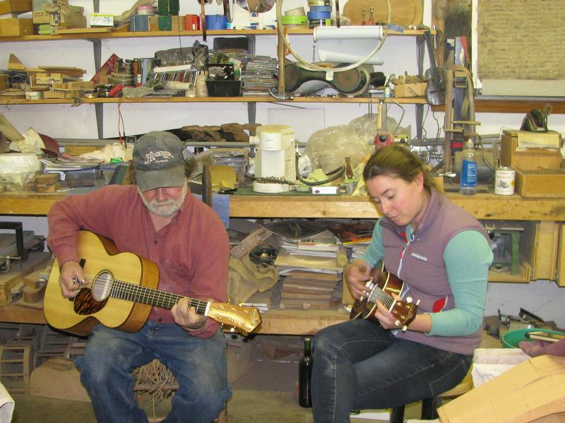 Jayne Henderson (right) and her dad, Wayne Henderson, test out a guitar and a ukulele in Wayne's shop in Rugby, Va.