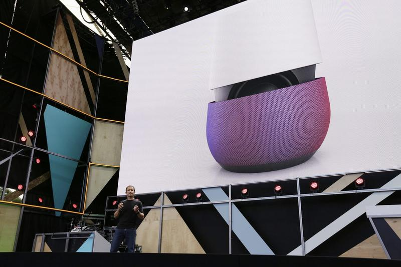 In this May 18, 2016 file photo, Google vice president Mario Queiroz gestures while introducing the new Google Home device during the keynote address of the Google I/O conference in Mountain View, Calif. On Tuesday, Oct. 4, 2016, the search giant will ramp up its consumer electronics strategy with expected announcements of new gadgets including new smartphones and an internet-connected personal-assistant for the home similar to Amazon's Echo speaker. (Eric Risberg/AP)