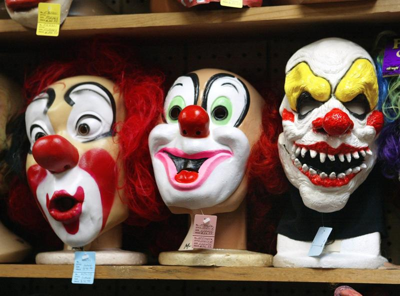 Scary clowns are seen in more than ten states in recent weeks. The photo shows clown masks displayed at the Fantasy Costumes HDQ. store on Oct. 17, 2003 in Chicago, Illinois. (Tim Boyle/Getty Images)