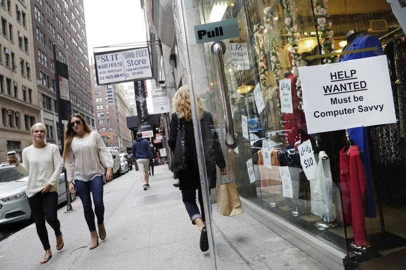 "A ""help wanted"" sign hangs in a store window in New York on Thursday, Oct. 1, 2015. (Mark Lennihan/AP)"