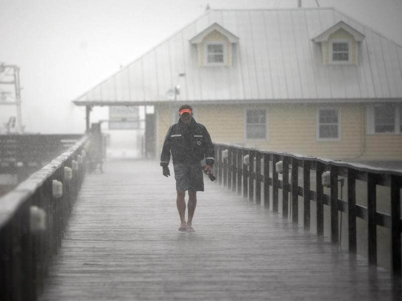 Bull River Yacht Club Dock Master Robert Logan leaves the dock after finishing up storm preparations as Hurricane Matthew makes its way up the East Coast, Friday, Oct. 7, in Savannah, Ga.