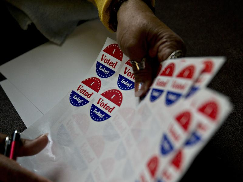"""A poll worker organizes """"I Voted Today"""" stickers at the Francis Myers Recreation Center polling location in Philadelphia, Pa., on April 26."""