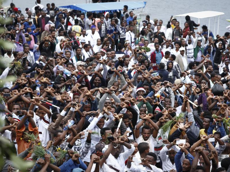 In a scene from Sunday, Oct. 2, festival-goers chant slogans against the government during a march in Bishoftu, Ethiopia. A week of violence prompted the country to declare a state of emergency.