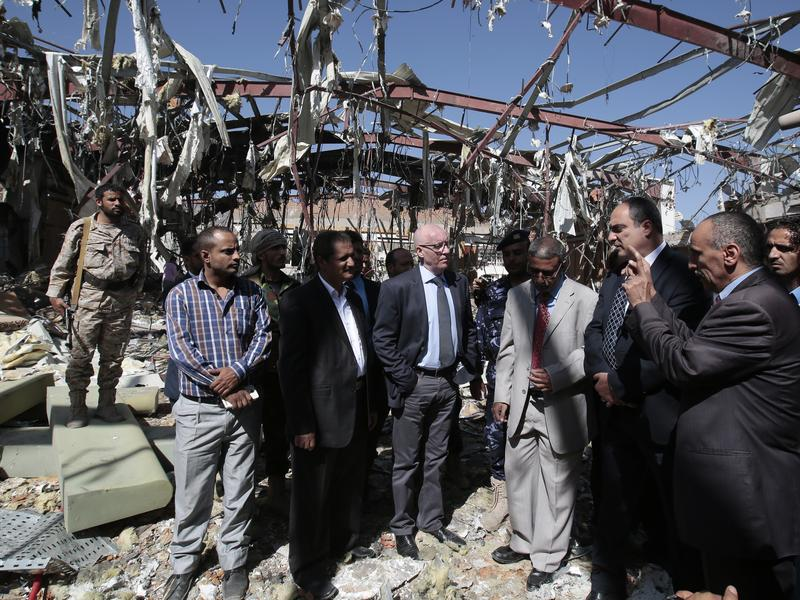 The United Nations humanitarian coordinator for Yemen, Jamie McGoldrick (center, in light blue shirt) inspects a funeral hall on Monday, two days after it was destroyed in Sanaa, Yemen, in an airstrike by a Saudi-led coalition. At least 140 people were killed.
