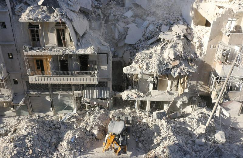 A tractor clears the rubble following Syrian government forces airstrikes in the rebel held neighborhood of Tariq a-Bab in Aleppo on Sept. 24, 2016. (Thaer Mohammed/Getty Images)