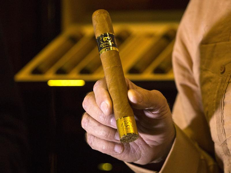 An official displays a limited edition Cohiba 50 cigar, one of 2,000 made for the 50th anniversary of the Cuban brand, on the opening day of the annual Havana Cigar Festival in February.